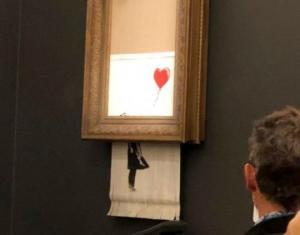 მილიონ  ფუნტად  გაყიდული ბენქსის  ნახატი პირდაპირ   აუქციონის მსვლელობისას  განადგურდა