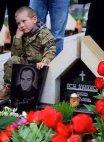ეს ის ბავშვია ვინც მამა დაკარგა 2008 წლის აგვისტოს ომში