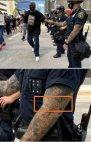 საინტერესო და უცნაური  ტატუა ამერიკელი პოლიციის ოფიცრის მკლავზე