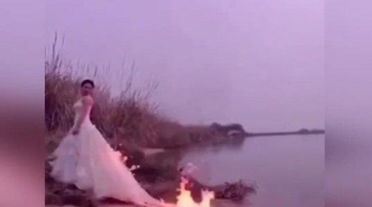 პატარძალმა ეფექტური ფოტოსესიის გამო კაბას ცეცხლი წაუკიდა