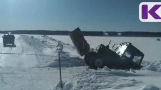 დათოვლილი ტბიდან ტრაქტორის ამოყვანა რუსულად. ბევრს იხალისებთ