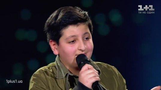 12 წლის ქართველმა ბიჭმა უკრაინის მუსიკალურ კონკურსზე ჟიური აატირა(ვიდეო)